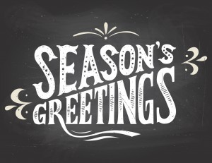 Season's greetings on chalkboard background