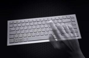 Hacking concept - Transparent hands over computer keyboard